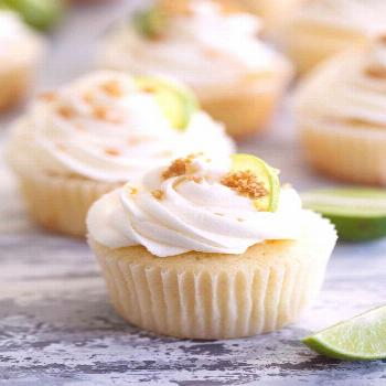 Tart and sweet, these Key Lime Cupcakes are lightly lime flavored cupcakes filled with key lime pie