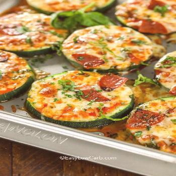 Zucchini Pizza Bites are one of our favorite snacks! These delicious pizza bites are topped with ou